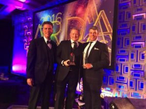 Karma Group CEO Gary Knowles accepts the award on behalf of the Karma Group at ARDA 2016, in Hollywood, Florida