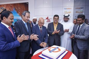 The cake-cutting ceremony at ITL World's new Ilford office