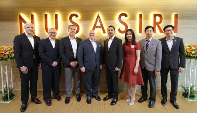Pictured at the Thailand signing are, from left: Holger Jakobs, Bruno Huber, Jens Reichert and Andrew Langdon of Mövenpick with Nusasiri's Khun Visanu Thepcharoen and wife Siriya, Somchitr Chaychana and Sithichai Sereepattanapol
