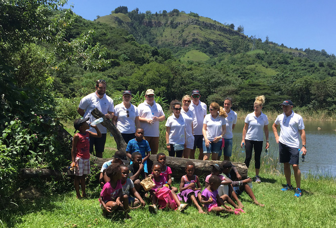 Pearly Grey staff with children from Yami Children's Village