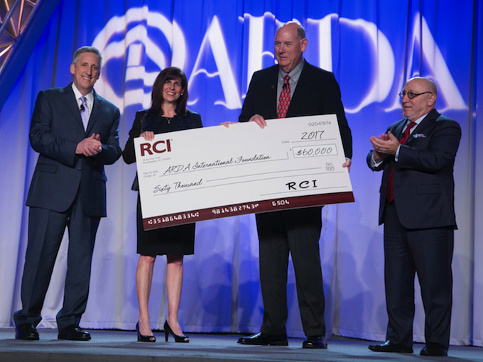At the cheque presentation, from left: Gordon Gurnik, president of RCI; Gail Mandel, CEO of RCI; Robert Miller, AIF chairman; and Howard Nusbaum, ARDA president and CEO