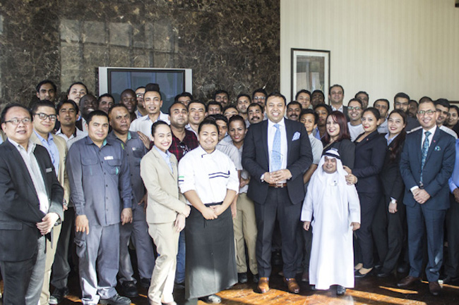 General manager Shahzad Butt and staff from Ramada Downtown Dubai celebrate the award