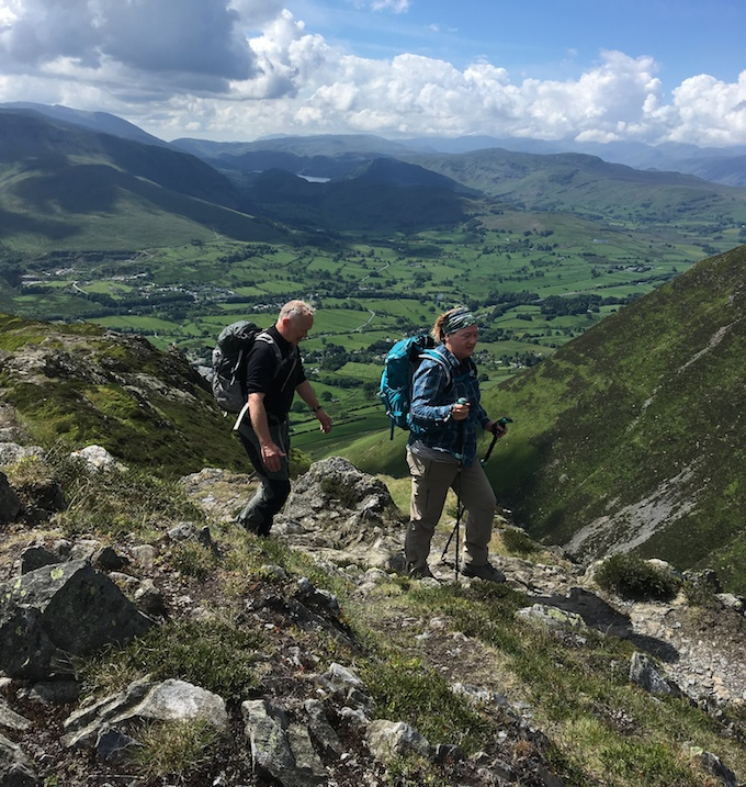Hikers enjoy the view from Blencathra in the Lake District