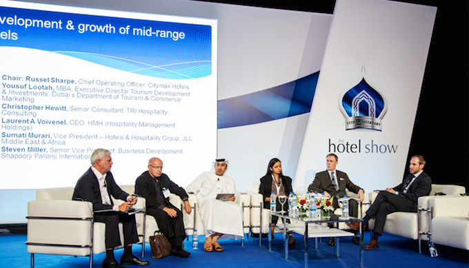 Laurent A. Voivenel (second from right) takes part in a panel discussion on the booming mid-market in Dubai