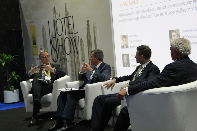 Laurent A. Voivenel (far left) joins a panel discussion at The Hotel Show