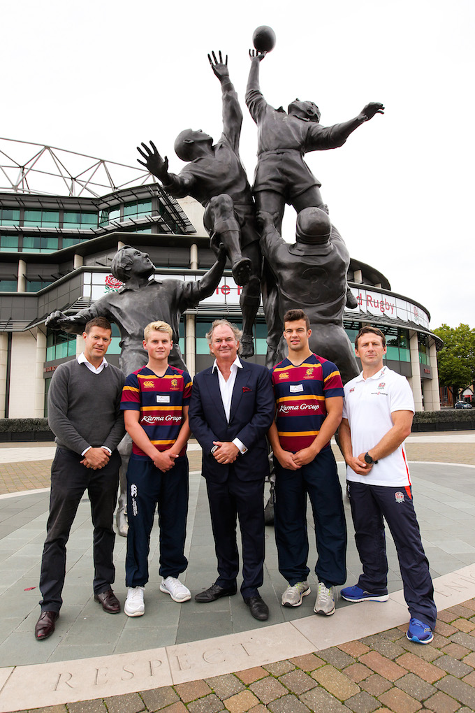 John Spence (centre) poses with Brighton College players and staff at the Core Values statue at Twickenham